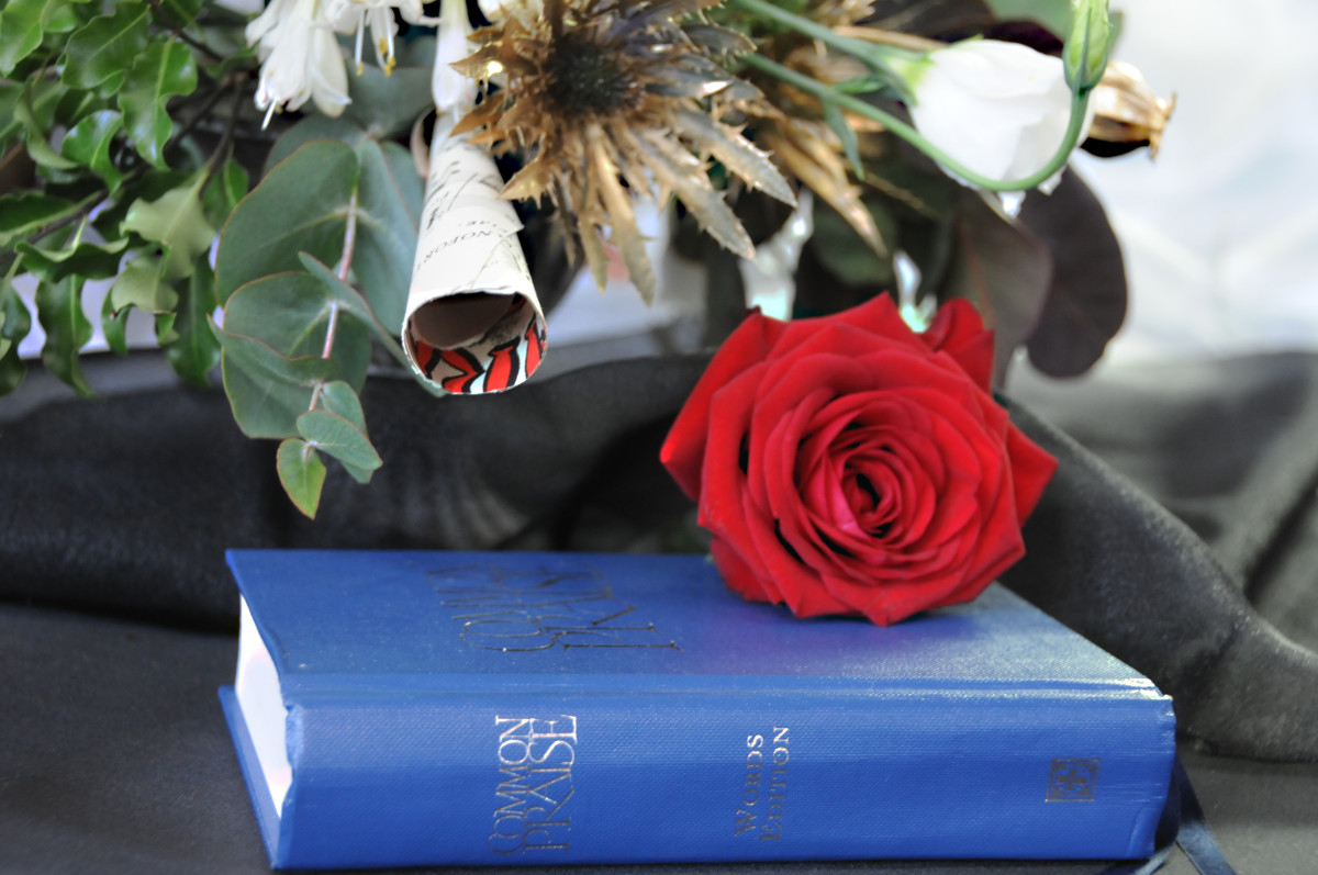A rose placed on The Holy Bible