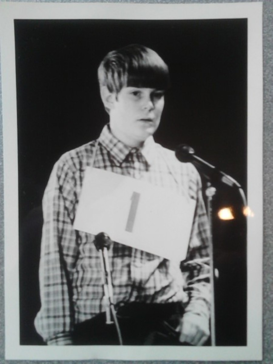 The author at 13, stepping up to the mic at the Spelling Bee. Hair by Weed Whacker, shirt by Krusty's Rodeo Clown Outlet.