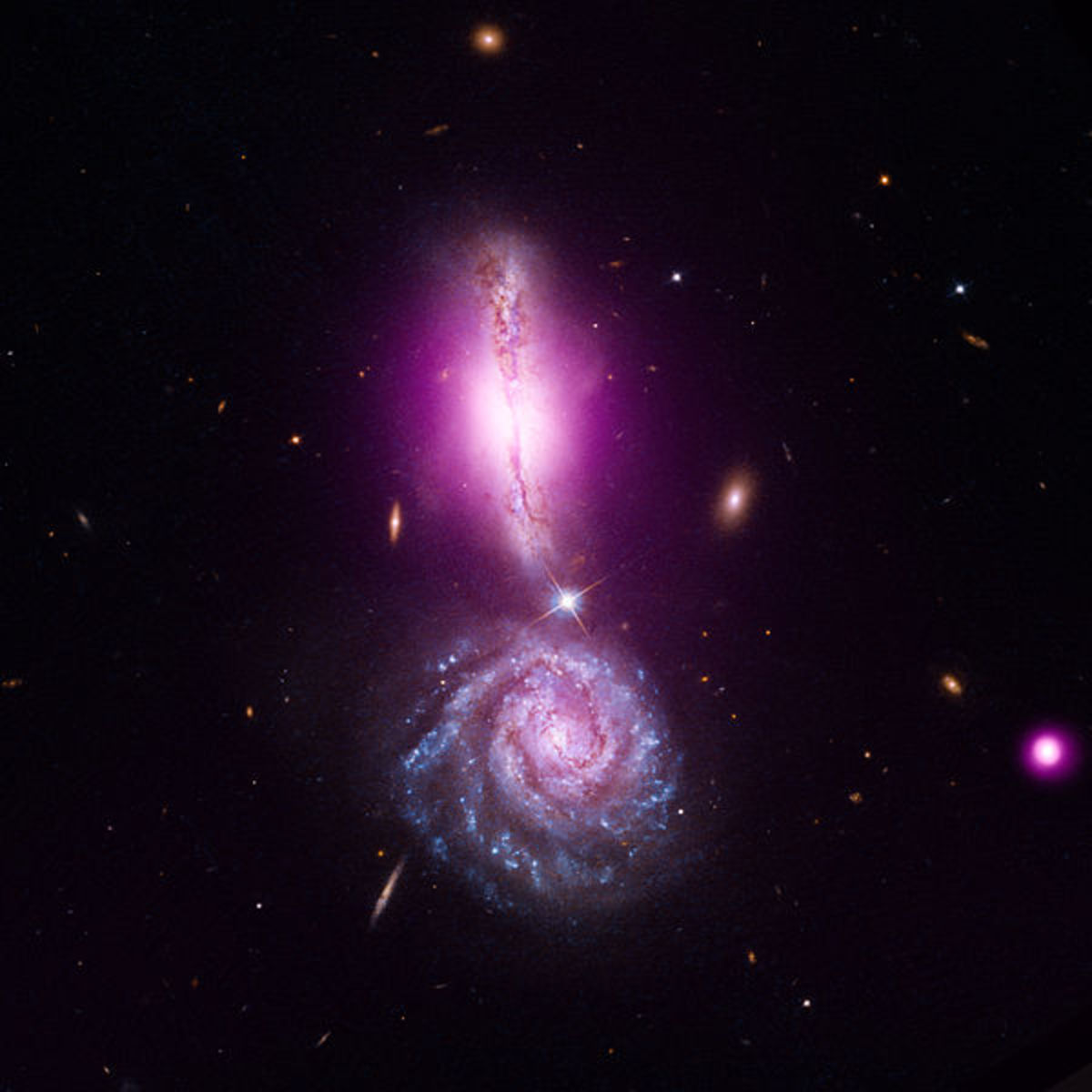 Exclamation point formed by galaxies headed for a merge that will take millions of years