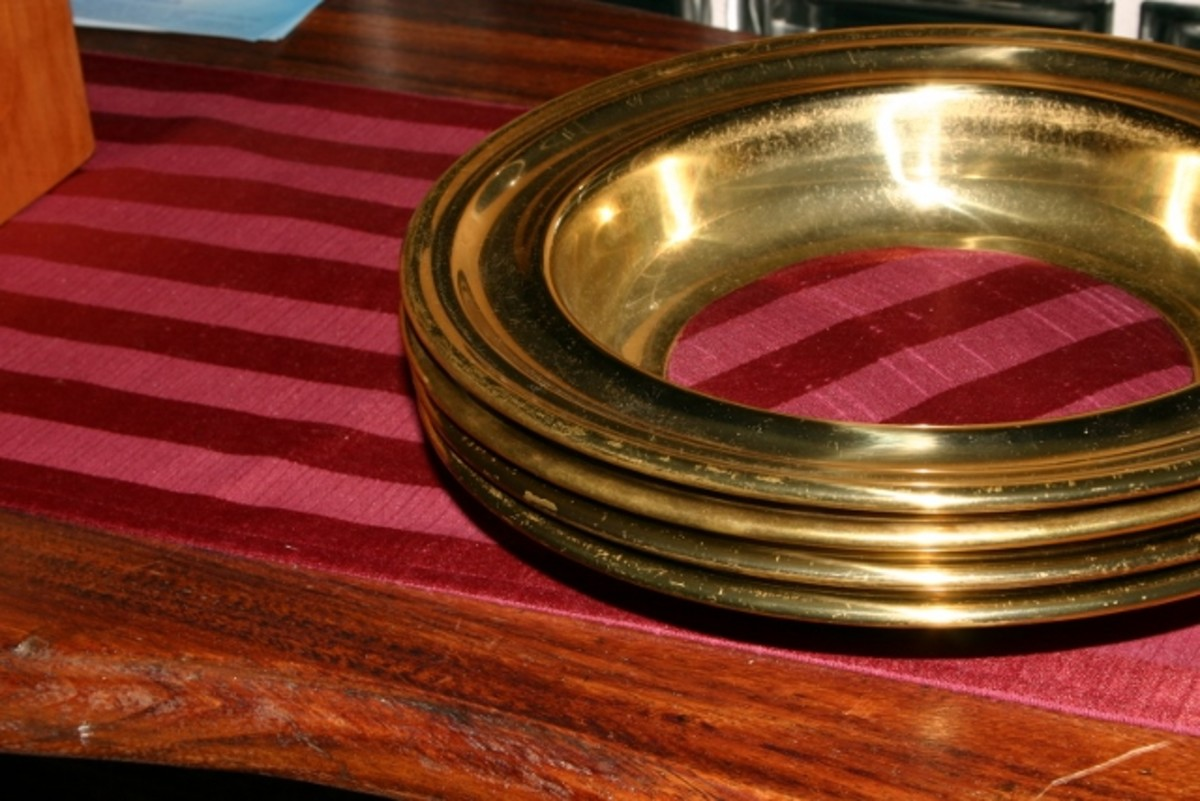 The collection plate is passed for parishioners to offer their weekly treasures to the church.