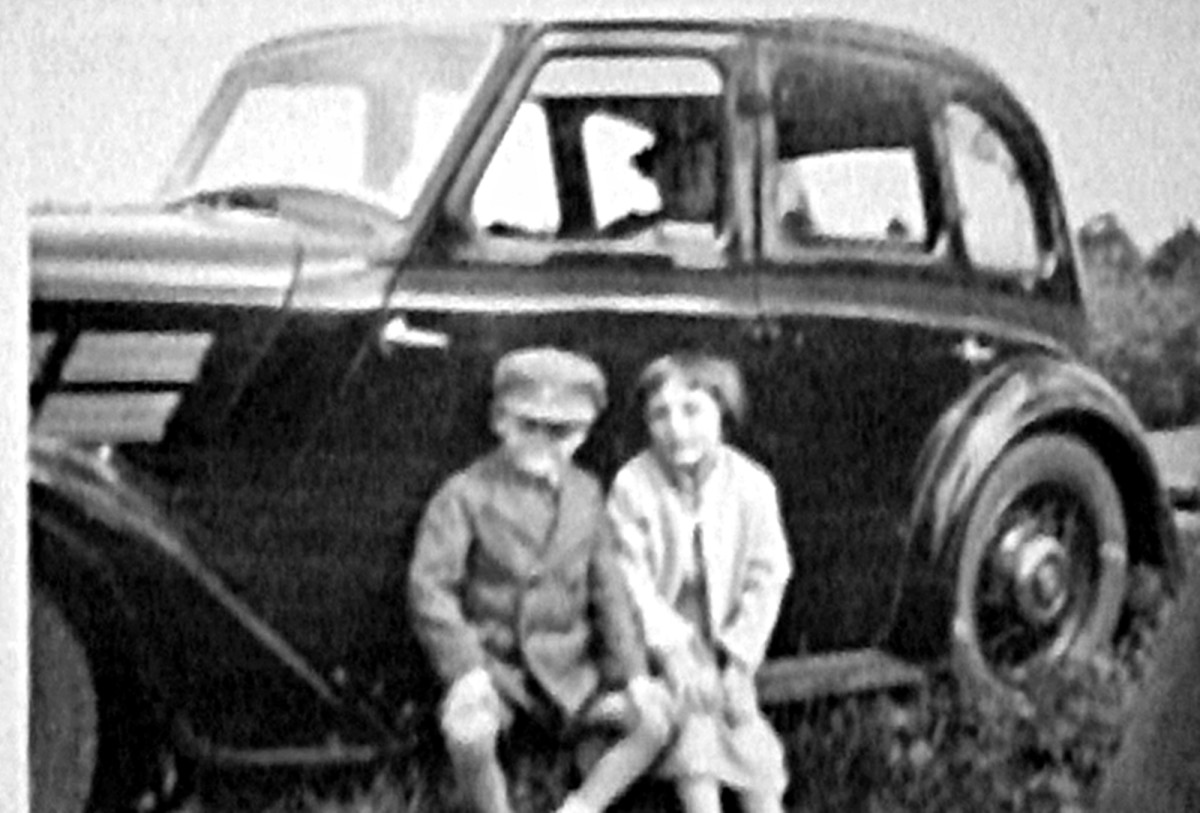 My mum Aud and her little brother Ken (sitting on their grandad's car, with their grandma in the back seat) in the 1930s