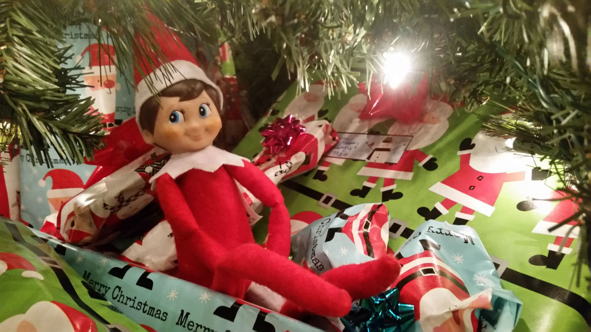 Put the elf under the tree for Christmas morning.