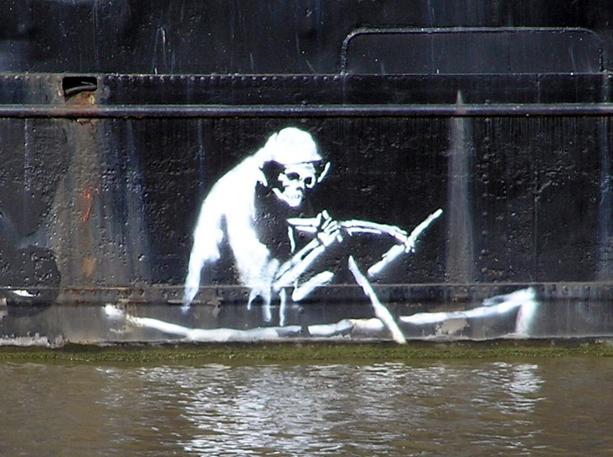A Banksy stencil of the grim reaper on the side of the Thekla, an entertainment boat in Bristol