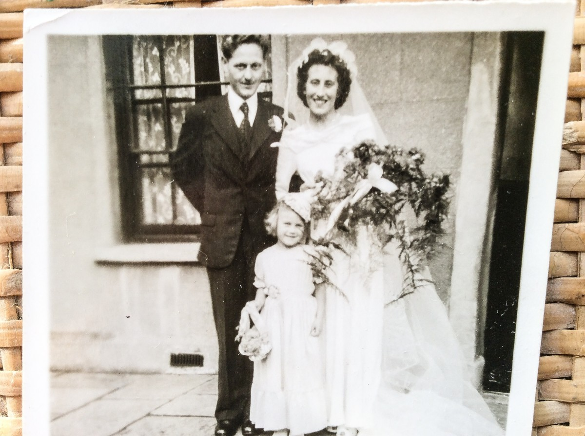 My parents outside the house on Fleet Street on their wedding day. The bridesmaid is one of my cousins.