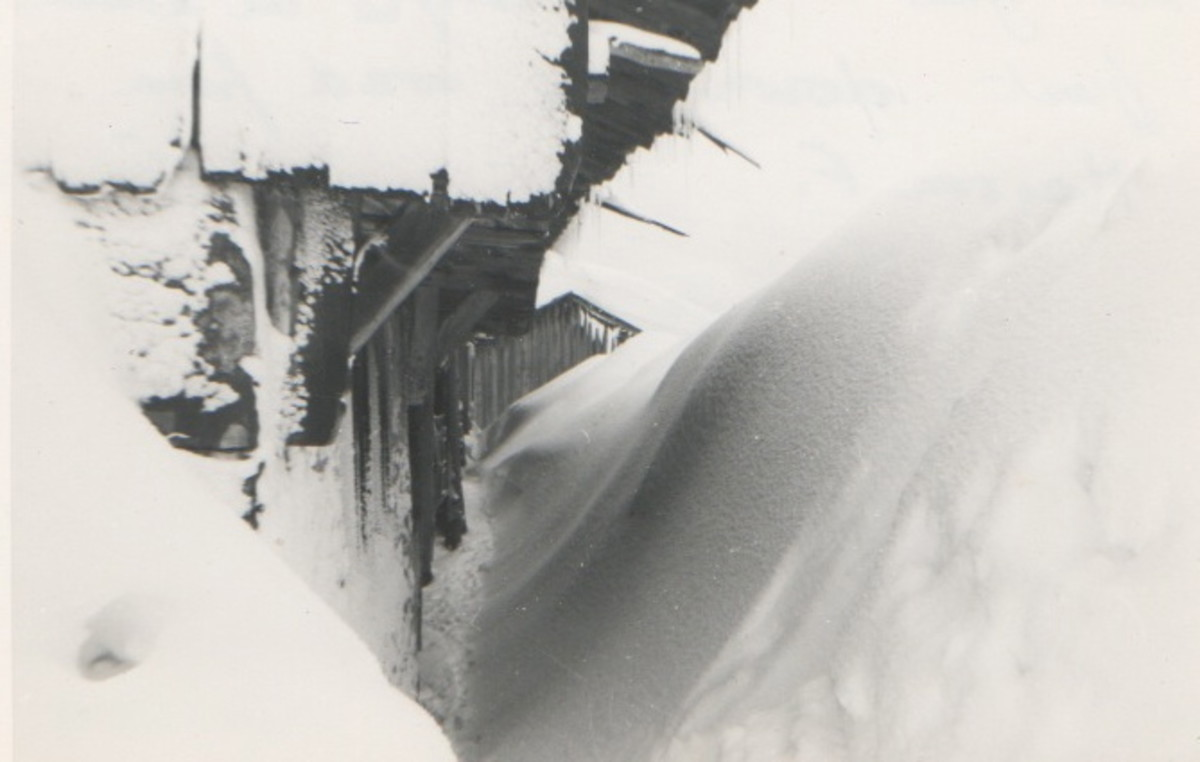 Snowdrifts by a Mountain Chalet