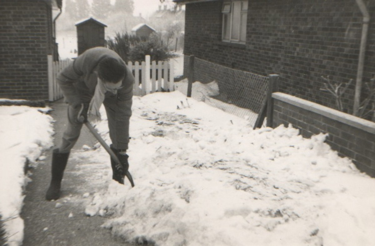 Dad clearing the Snow