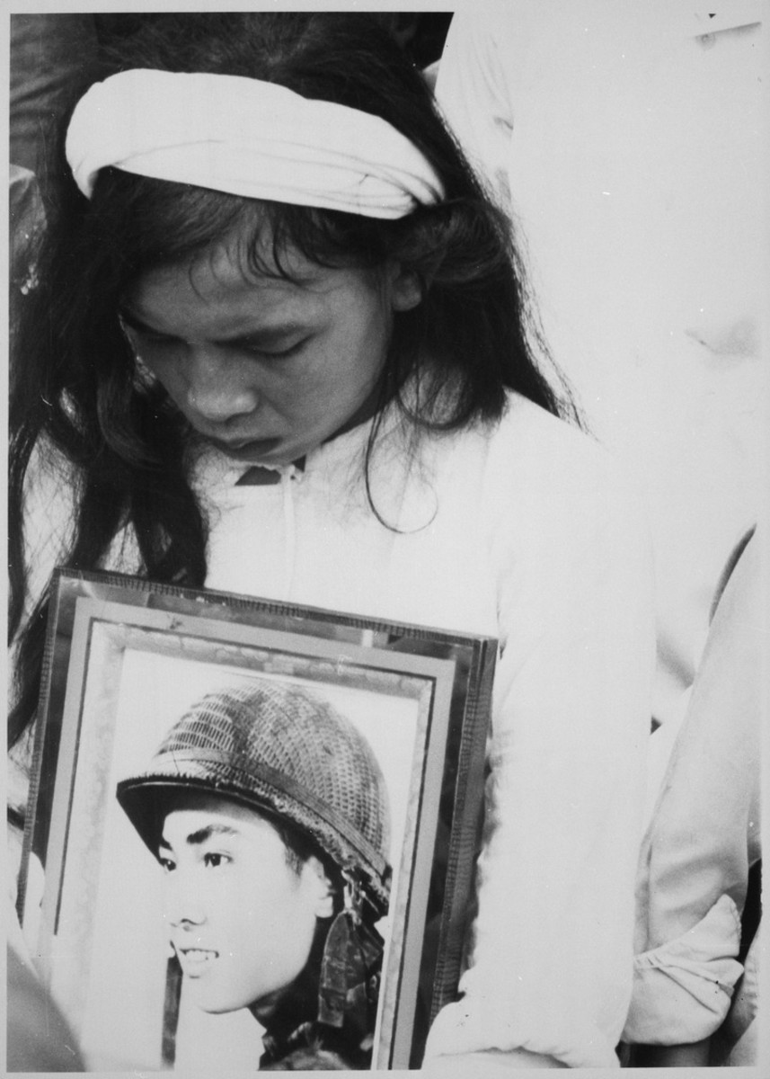 Mourning the travesty of war.  Photographer unknown. (U.S. National Archives and Records Administration)