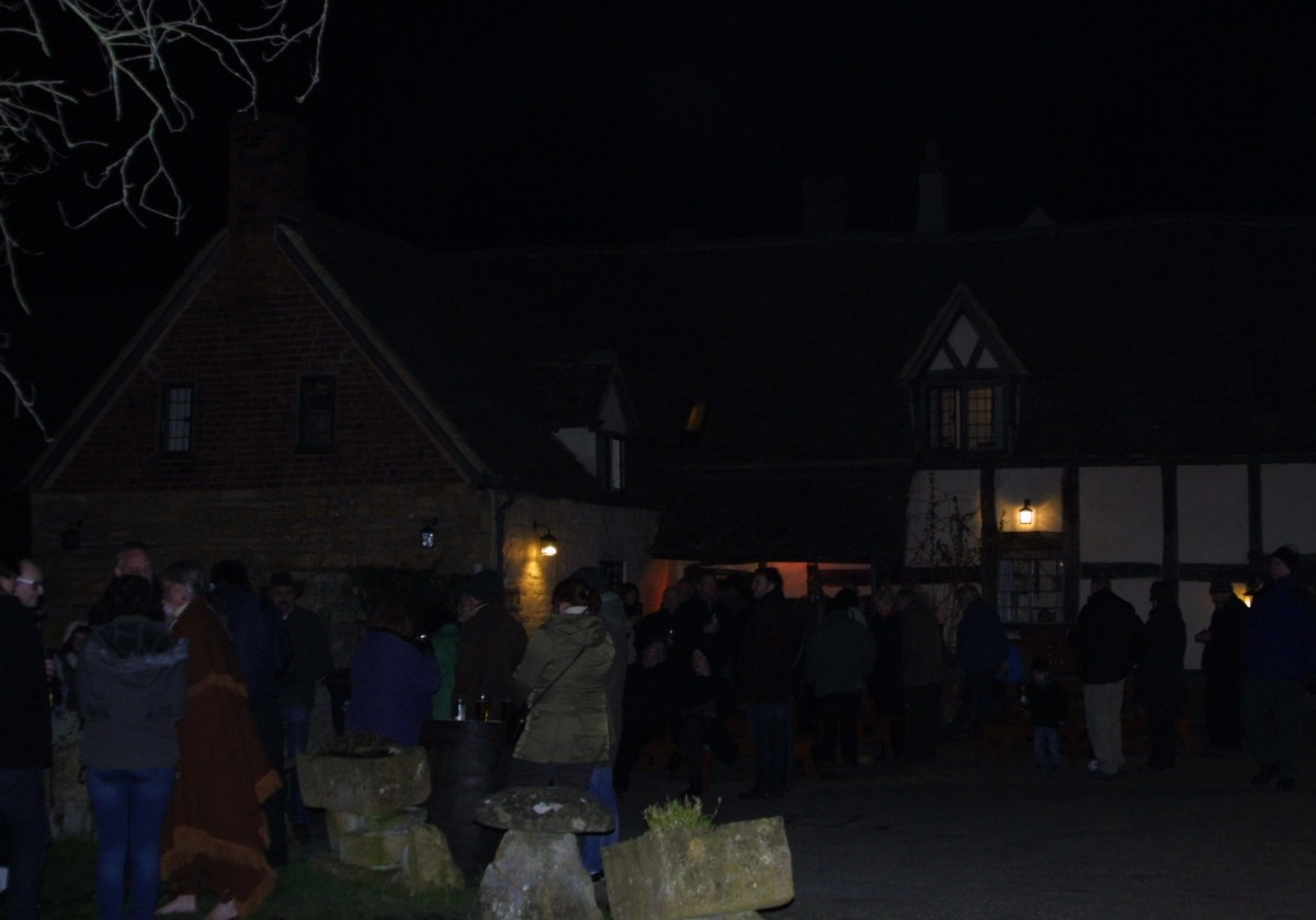Crowds gather around the courtyard at The Fleece Inn, Bretforton.