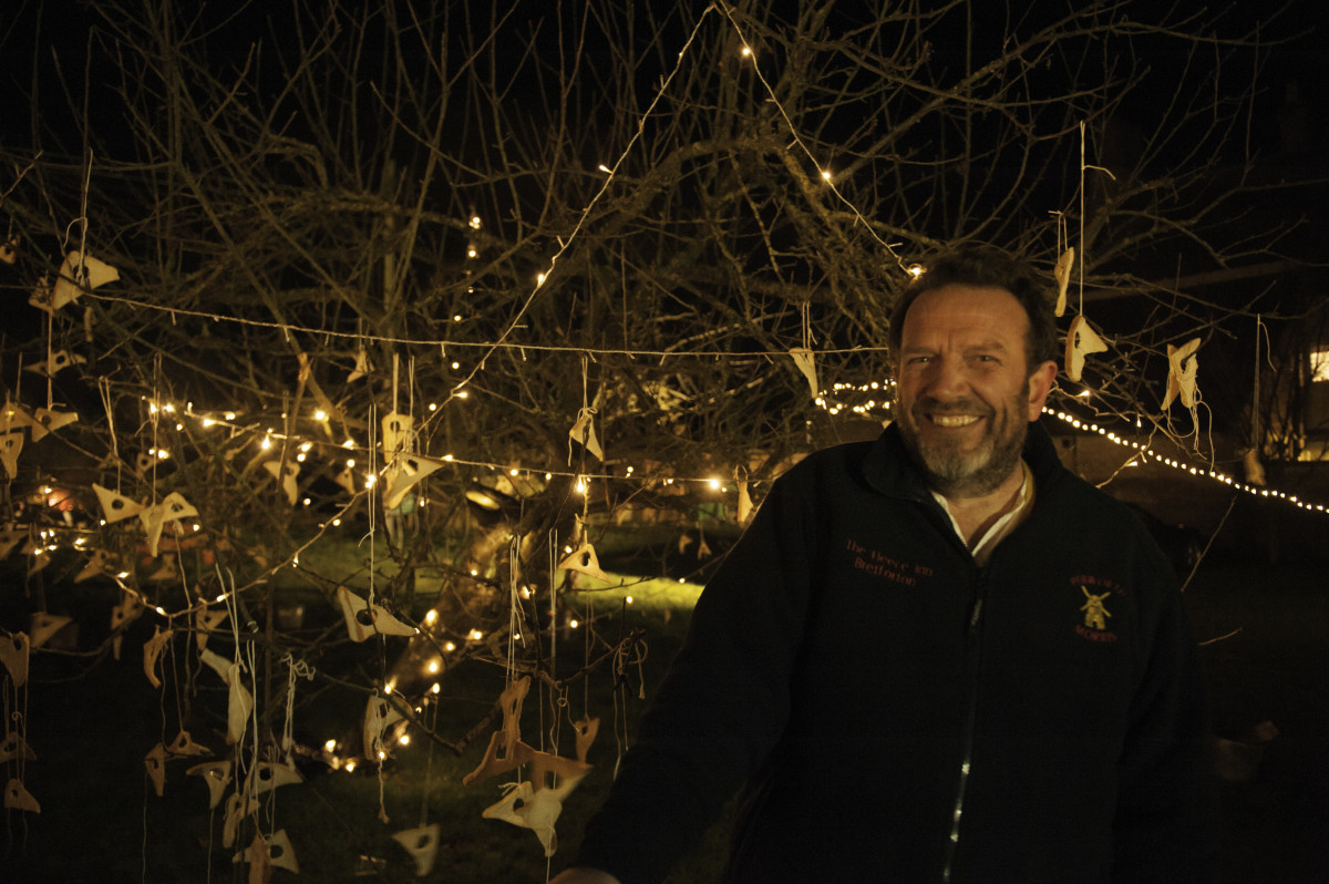 Nigel Smith, landlord of The Fleece at Bretforton, with the orchard in the background.