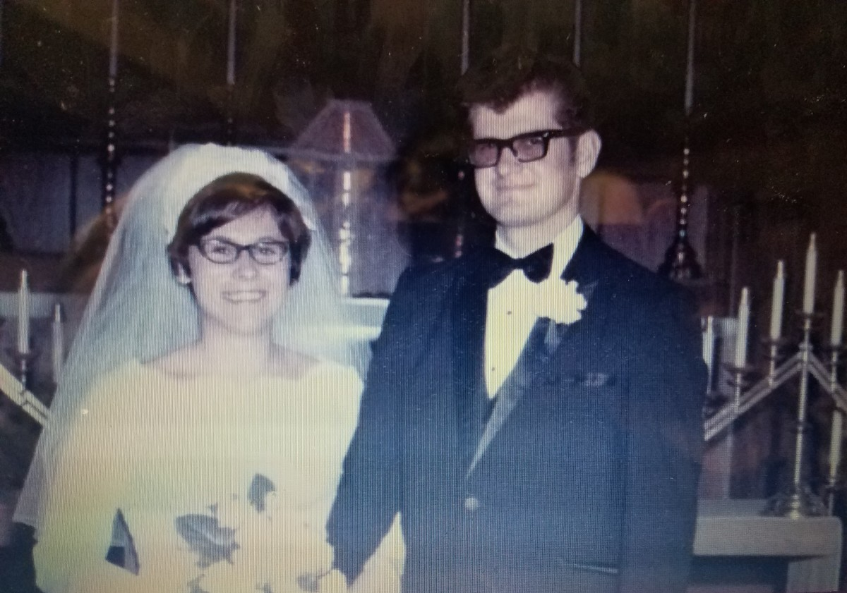 My mom had a Cathedral length train, an orchid corsage in the middle of her bouquet and a wedding cake that was shaped like a Cathedral. She got married Labor Day weekend, so she had her attendants in forest green, purple, fuchsia, and copper.