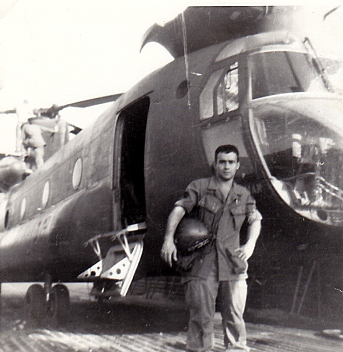John in front of the helicopter he had to maintain.