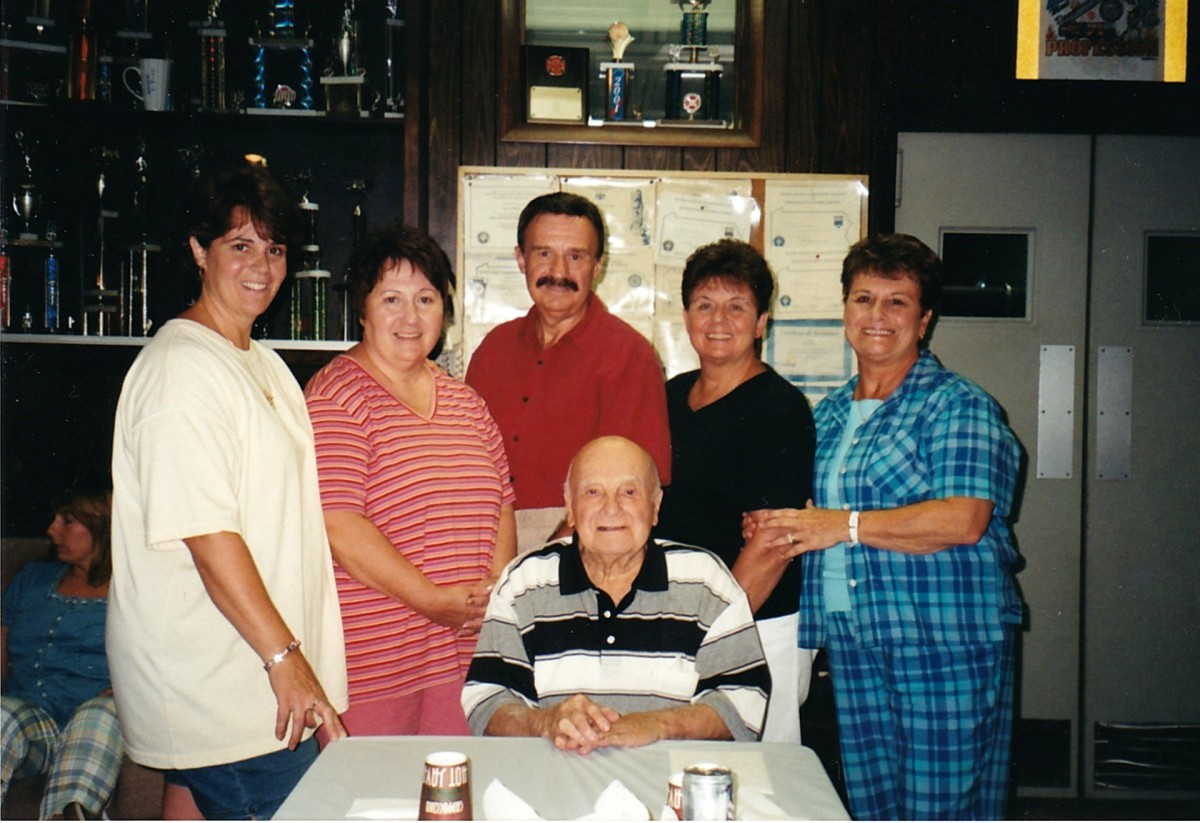 Left to right: my sister, Christine, me, my brother, my sisters, Joyce and Marian.  My father sitting down.  My mother had passed away by this time.