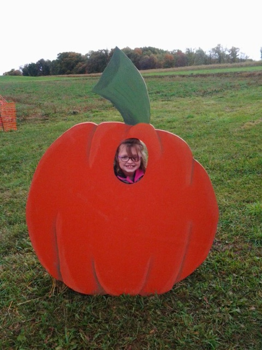 My granddaughter Leah is in the pumpkin cut out.