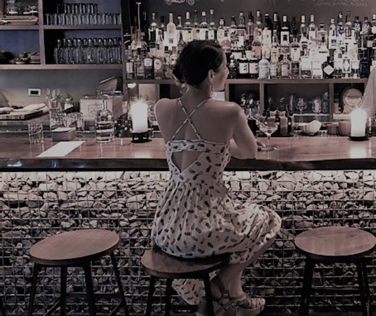 She stayed a while longer to finish her drink. Then, she paid her tab and left the scene, feeling emptier than when she had entered.