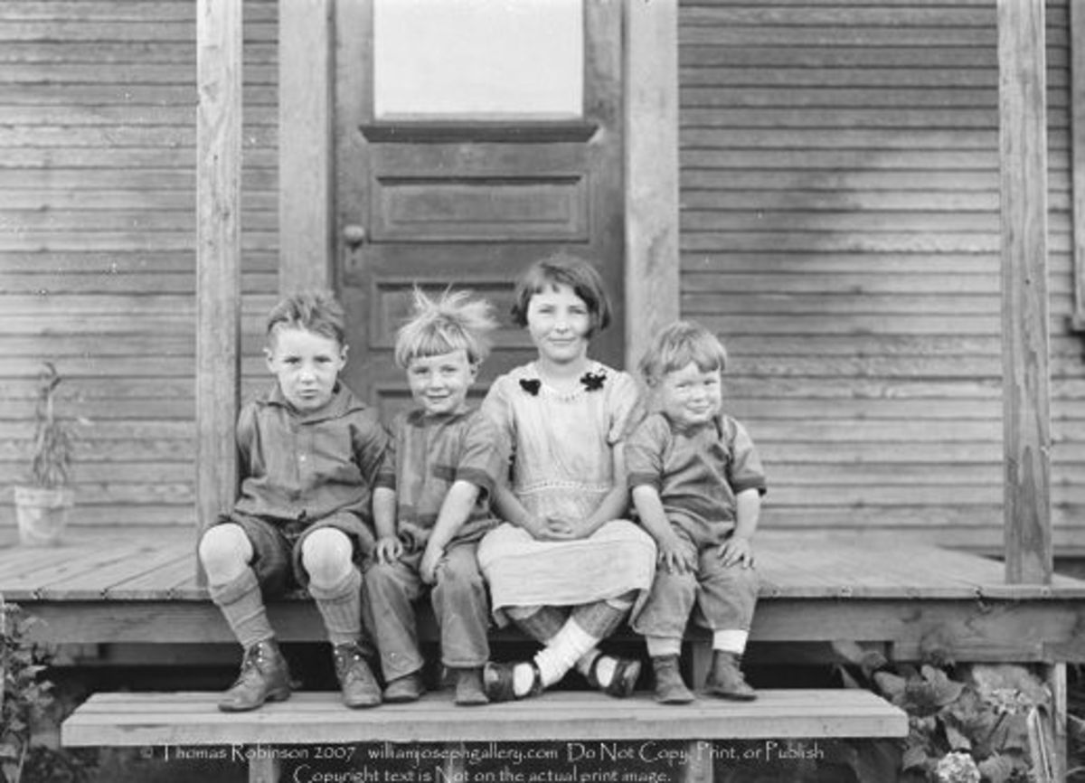 Four Children on a porch  in the United States circa 1910. Photo Archive on Getty Images.