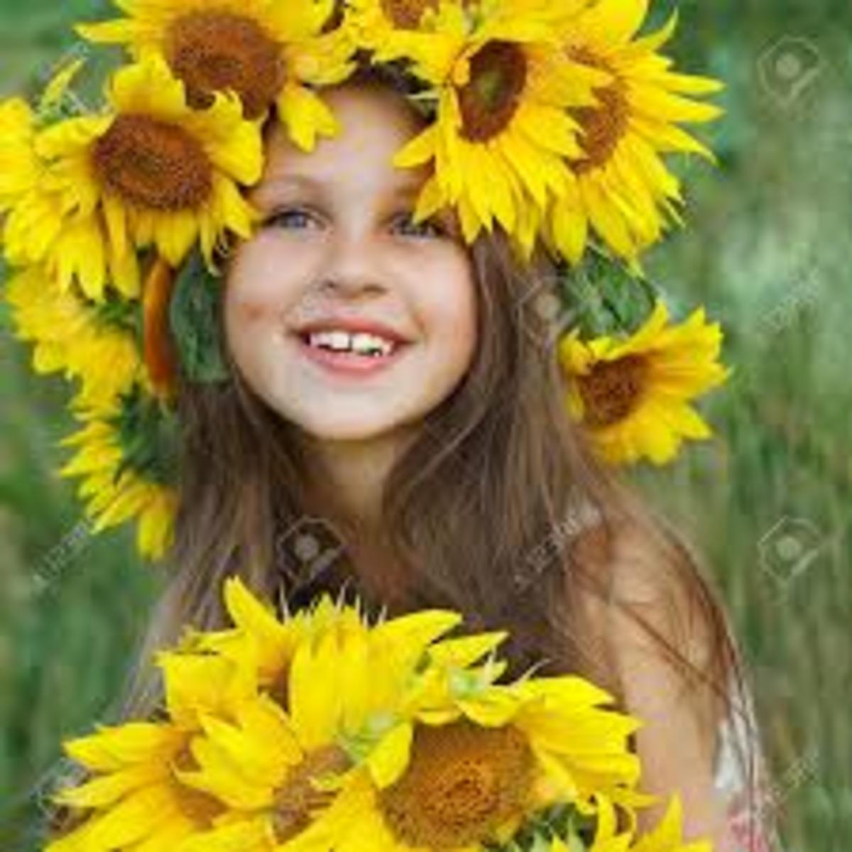 The big bright sunflower, looking at the sun  was the home of the girl where she stayed with fun .