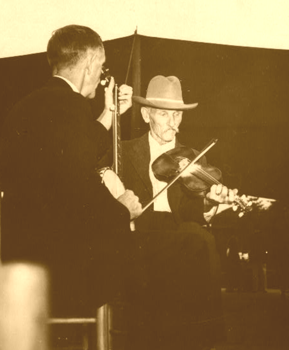 One of my dad's fiddling heroes was fiddlin' Bill Hensley, (right), who played in numerous fiddling conventions and contests.