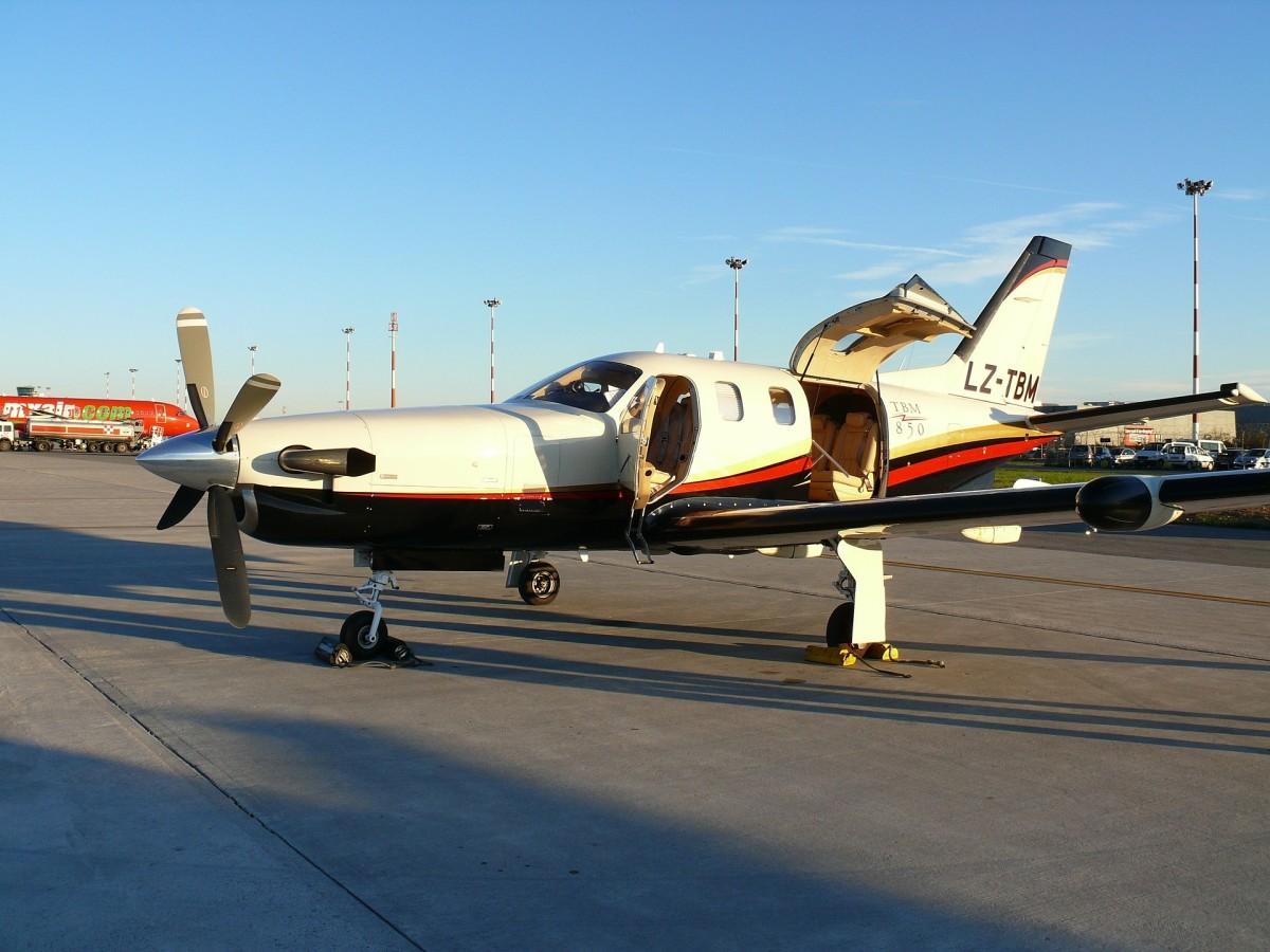 The jet sat quietly unprepared for flight except the door was open...
