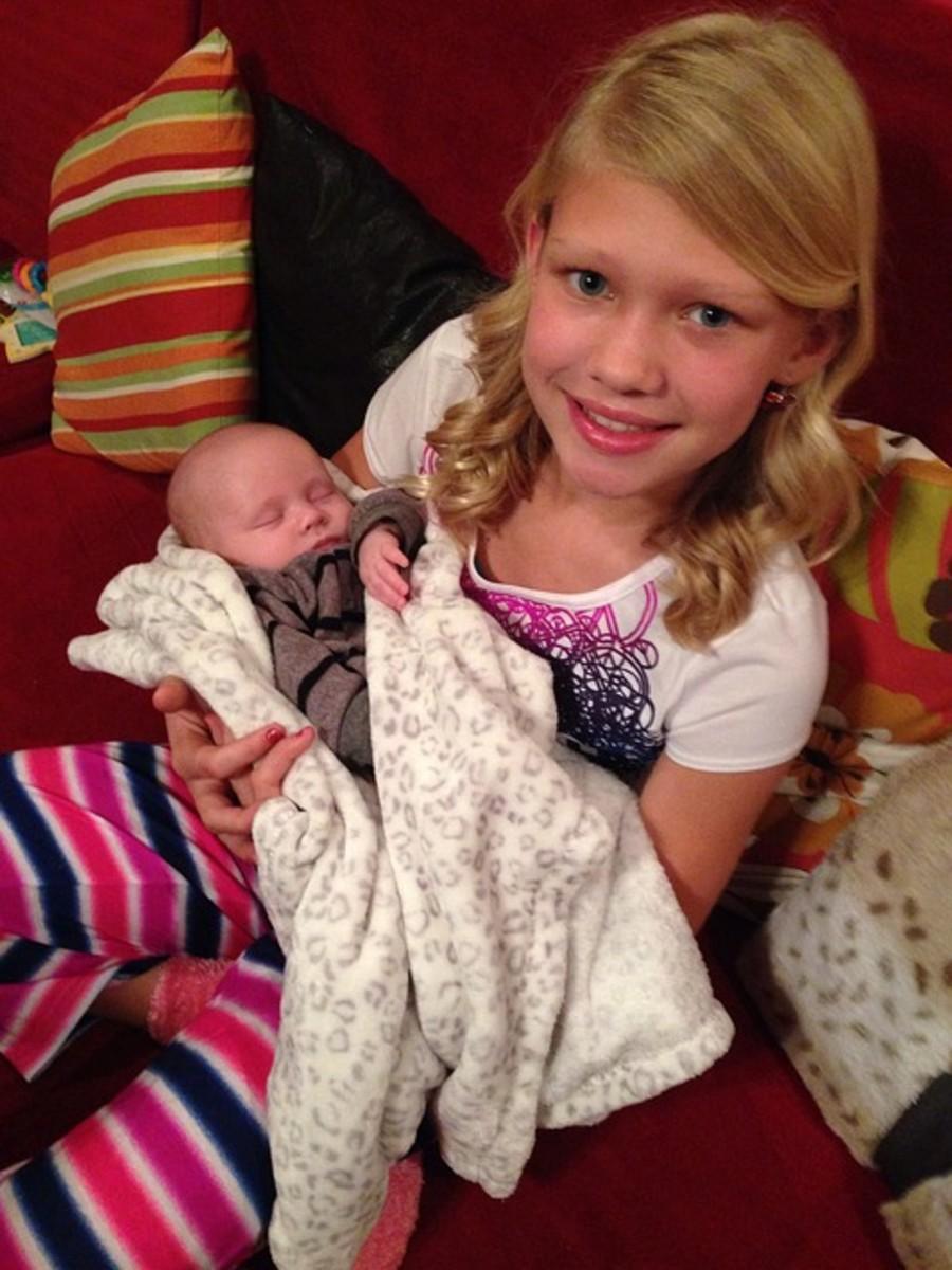 Young Teagan with Brayden as a baby.