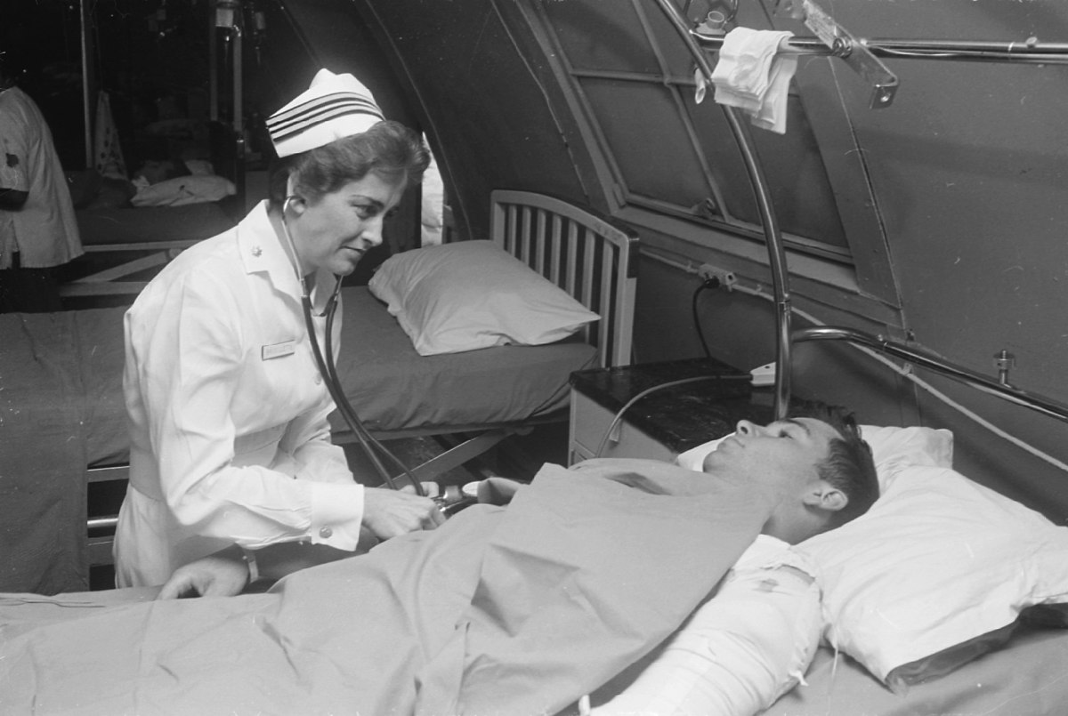 Lieutenant Commander Joan Brouilette with a patient at the hospital in Da Nang, South Vietnam, 1968.