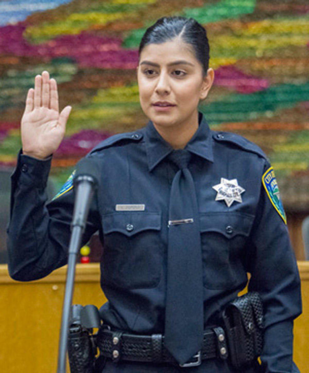 "Officer Natalie Corona a beat police officer. I publish this photo and the one at the top in memory of my good friend, ""Bud."""