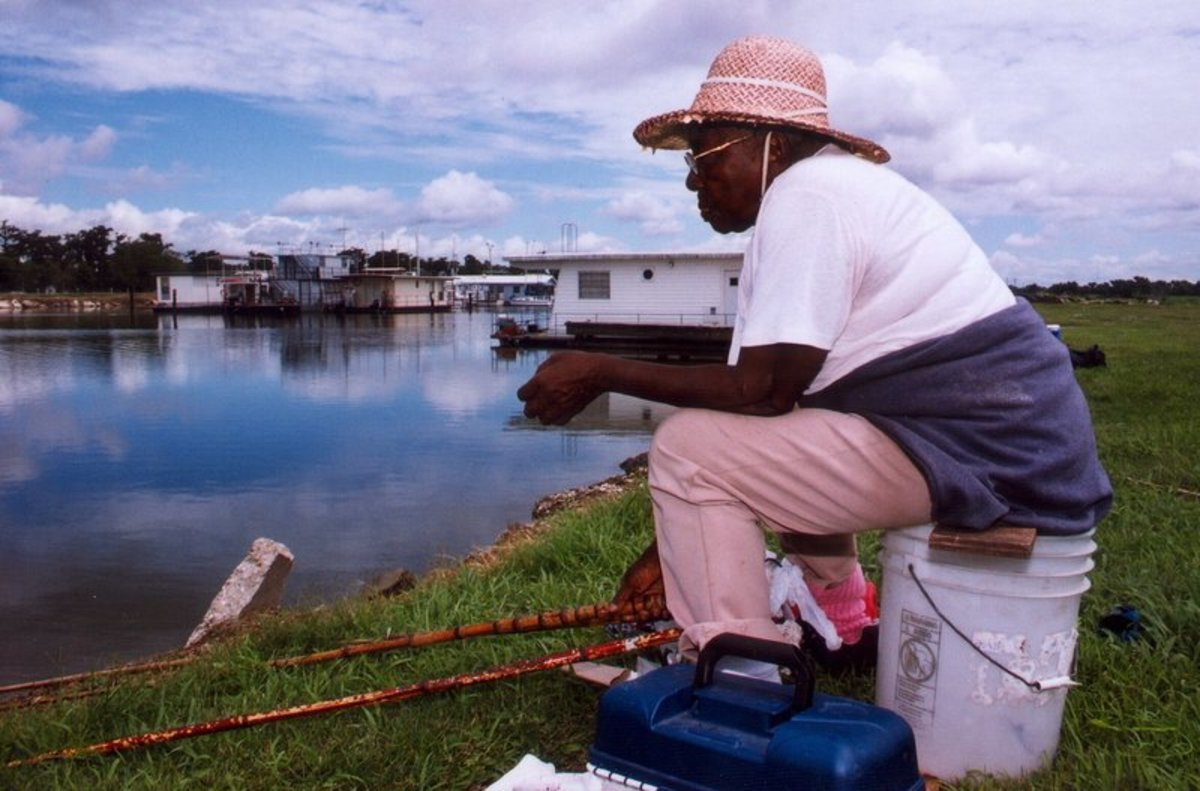 Woman cane  fishing in Morgan City, LA.