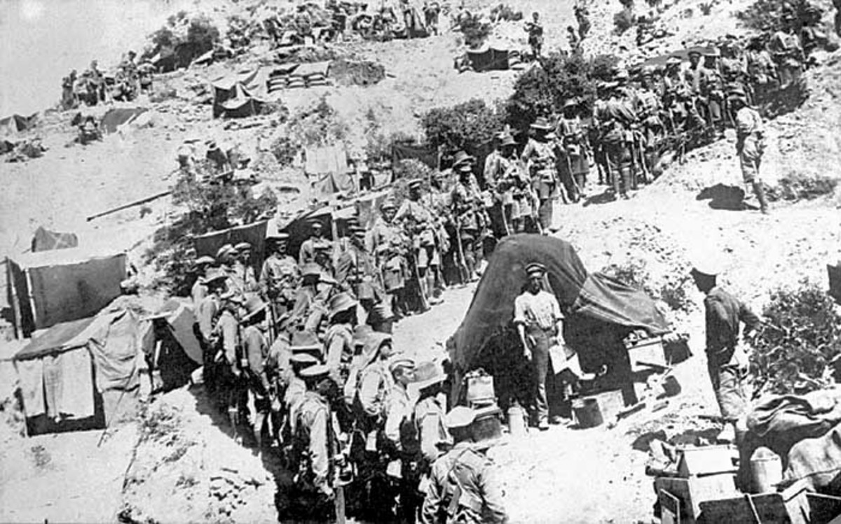 A platoon of the 13th Battalion, 4th Brigade, AIF, awaits an address by its commander Captain Joseph Lee, in the Sphinx Gully, Gallipoli probably prior to the brigade's night march on 6–7 August 1915 to attack Kocitemenepe.