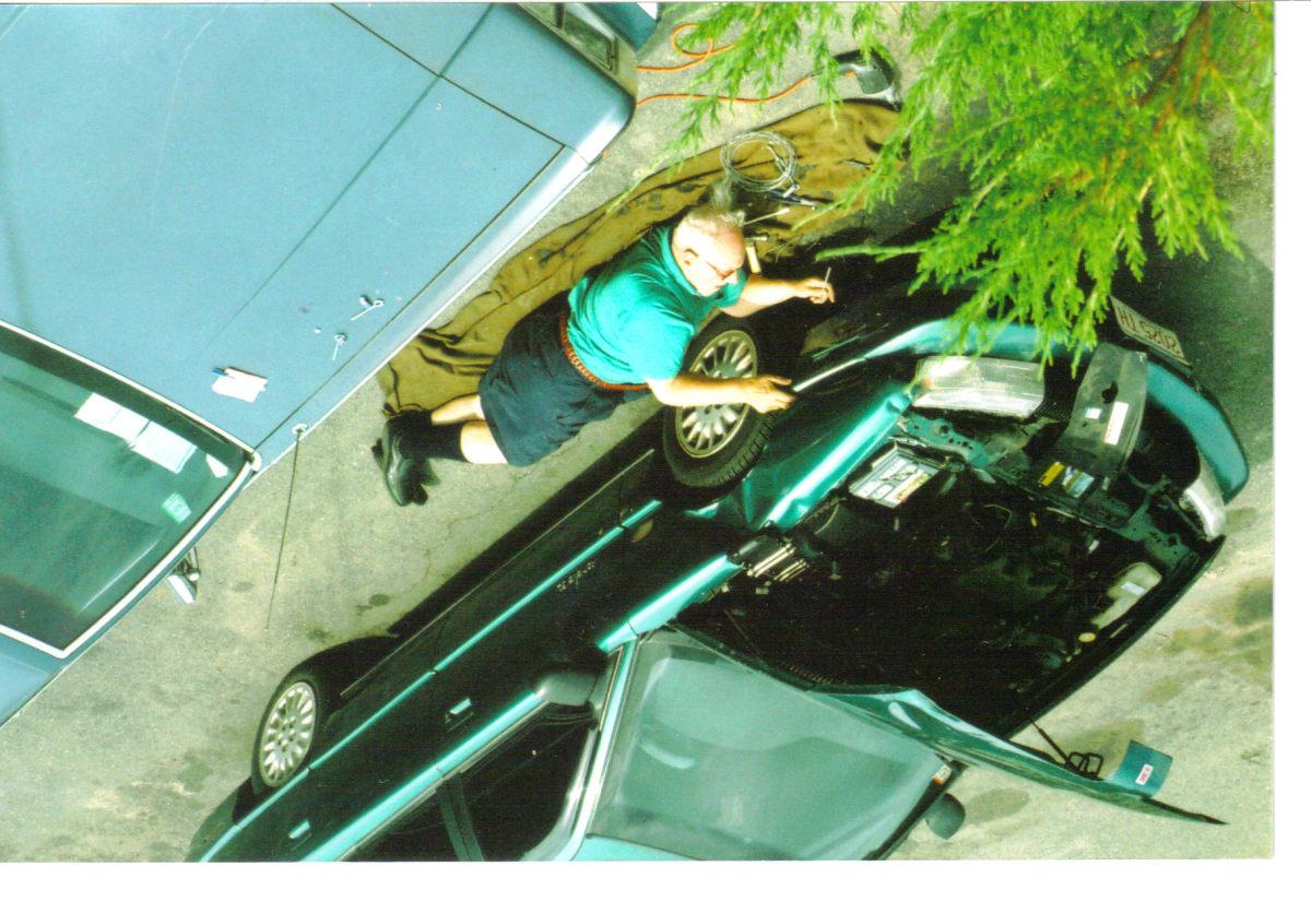 My dad fixing my car