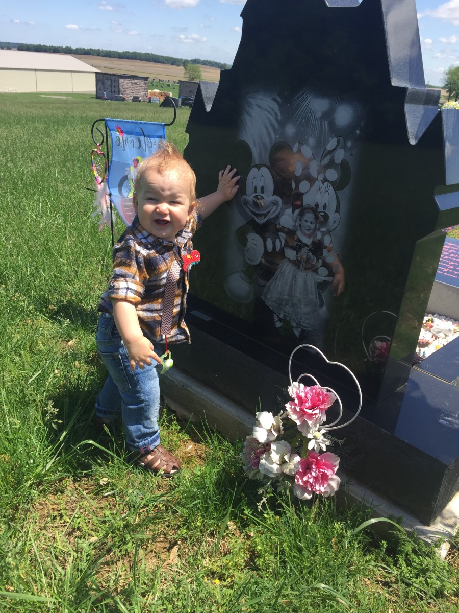 Grayson spending a little time visiting his big sister.