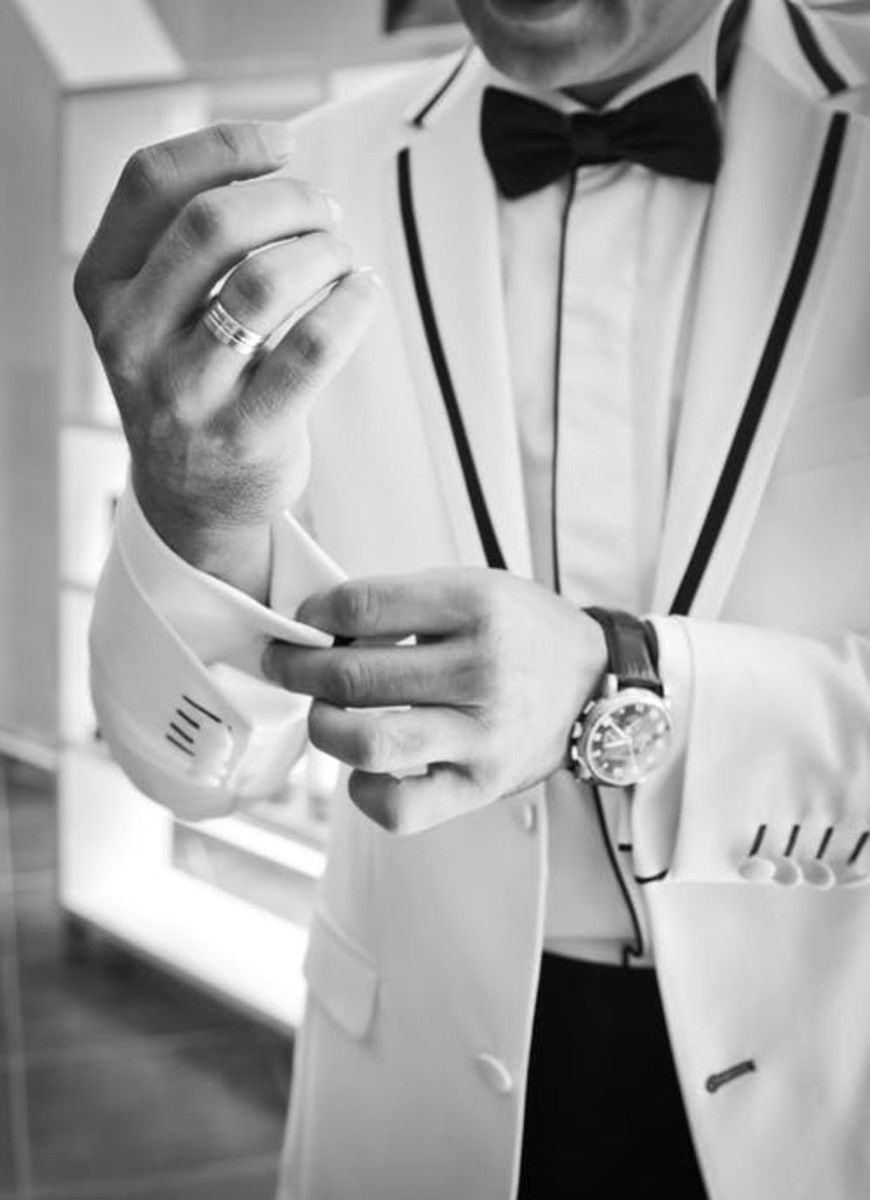 White Tux, Expensive Watch, Bow Tie: Man And Tie Are One.
