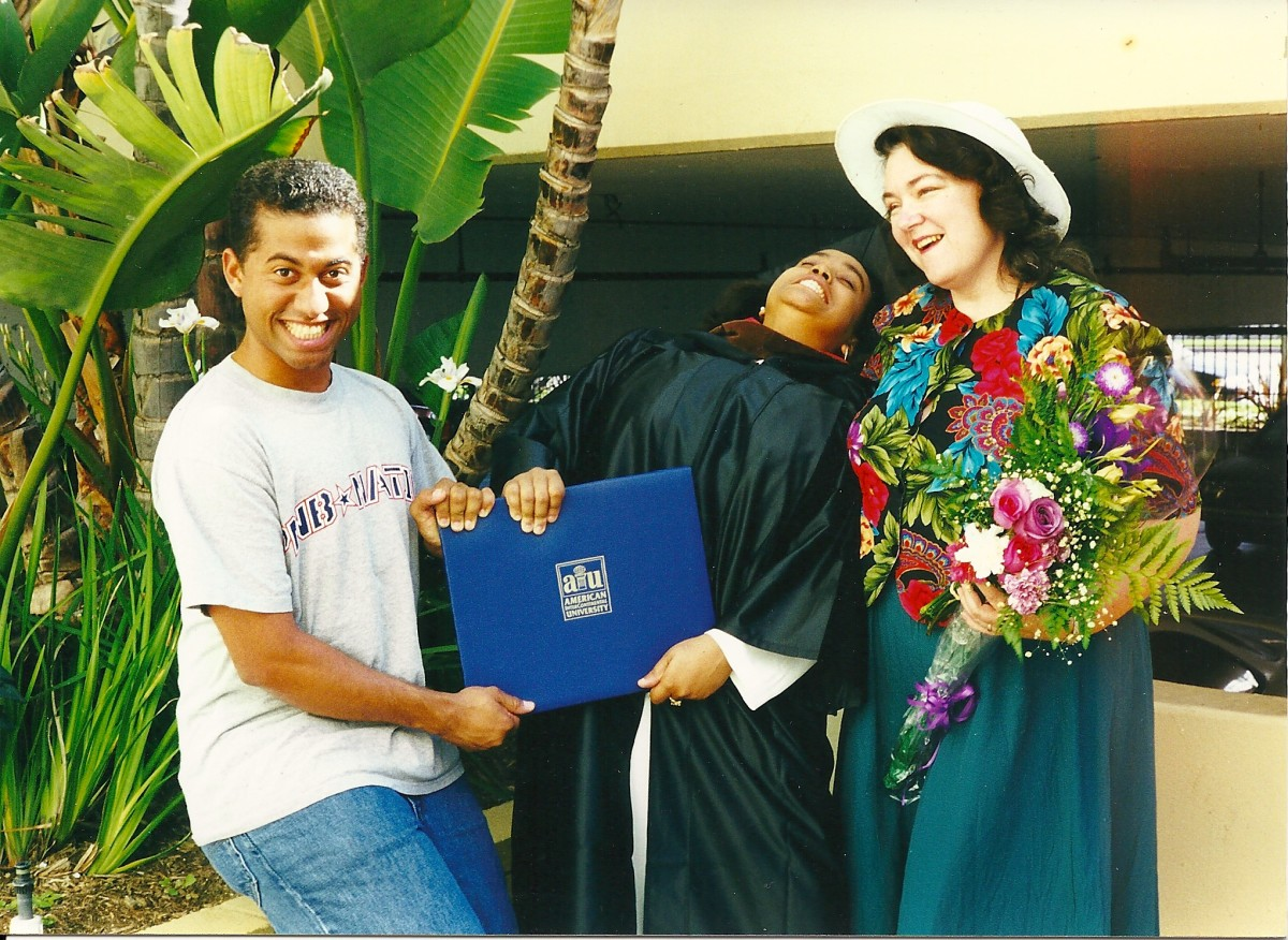 Me on the far right and two of the teenagers having fun, fighting over the diploma.
