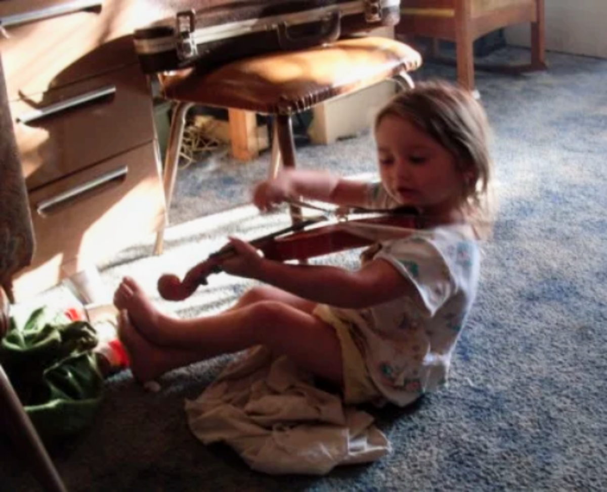 At this age, stuffed animals, violins, and toads all mix beautifully in an afternoon's play. And don't forget the blankie.