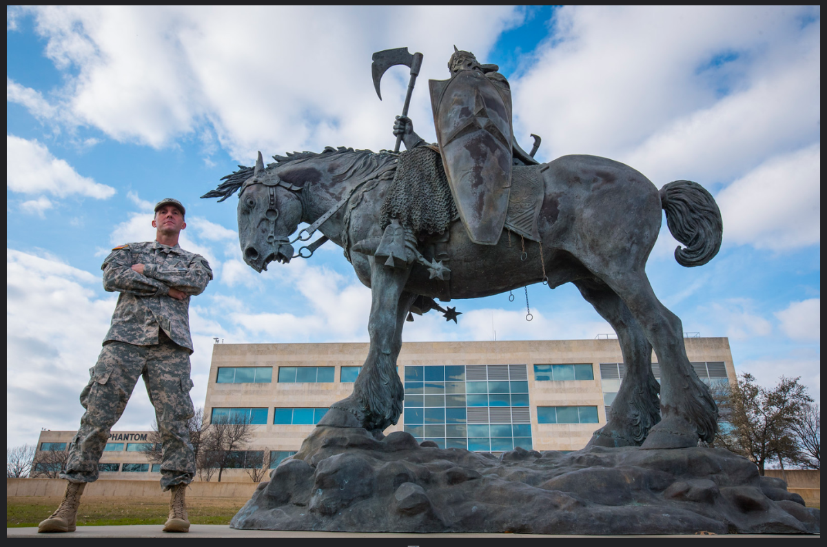 """With the """"Death Dealer"""" statue outside the III Corps HQ building on Fort Hood."""