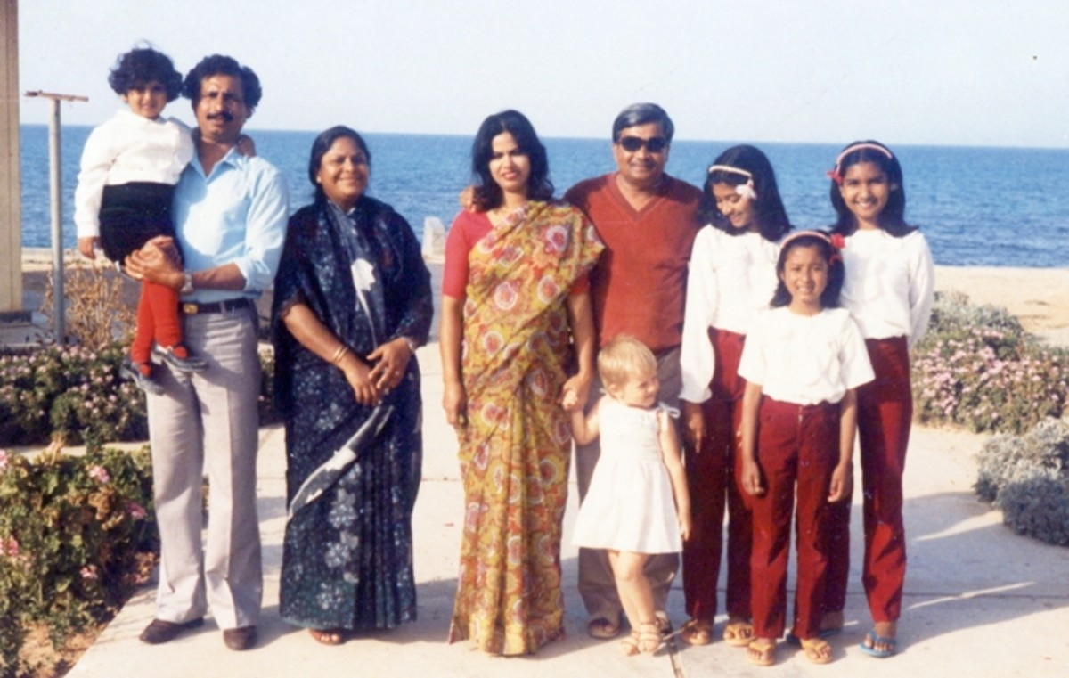 Pic5: Snapping with a Deshi Family with the Sea in the Background