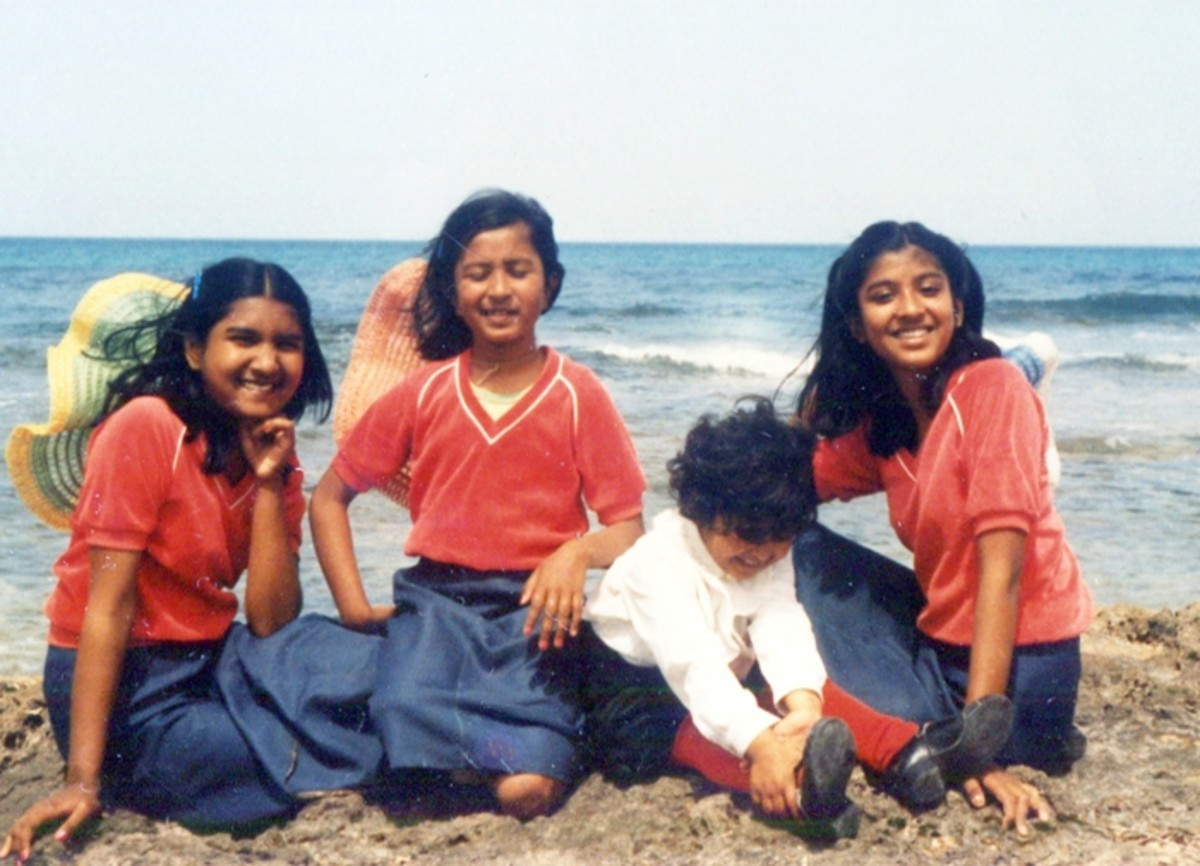 Pic19: My Sisters and I Sitting Near the Sea Along with a Family Friend's Little Daughter