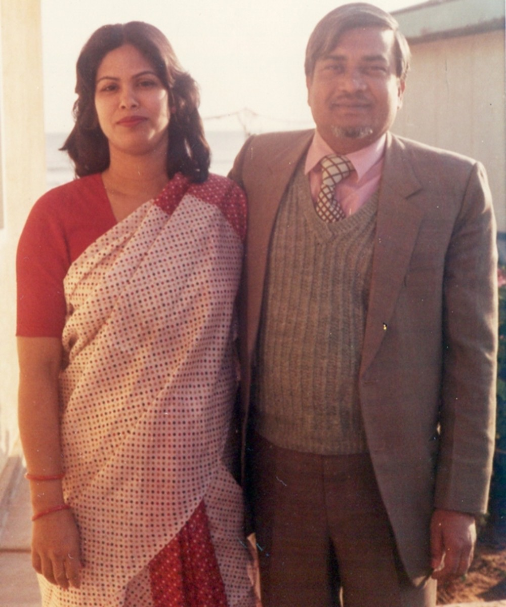 Pic12: My Parents in Blooming Winter in front of Our Home