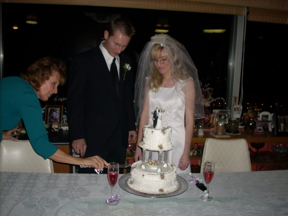 My husband and I. The cake that my gram made and the dress she fixed.