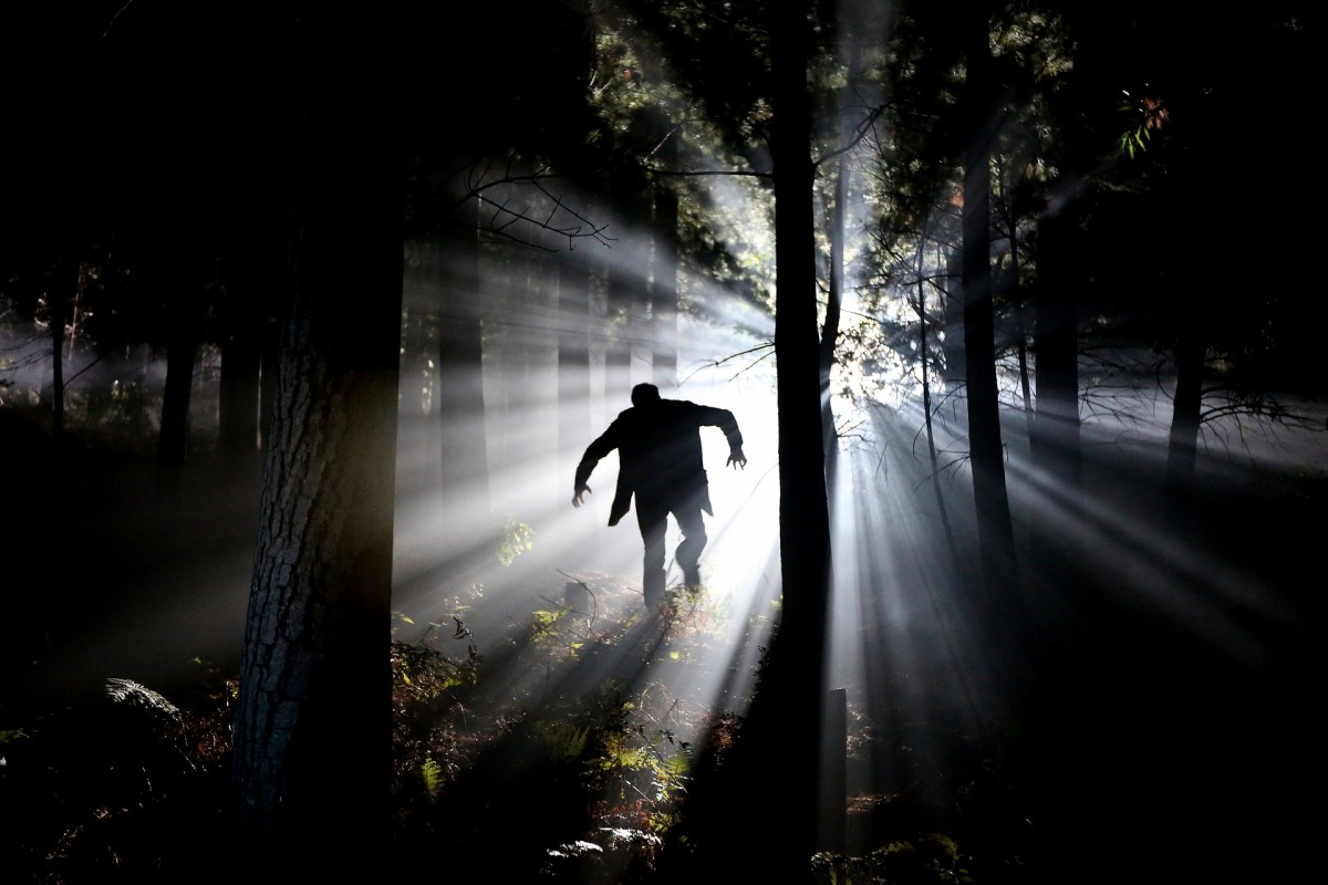 Terrified boy fleeing the monster