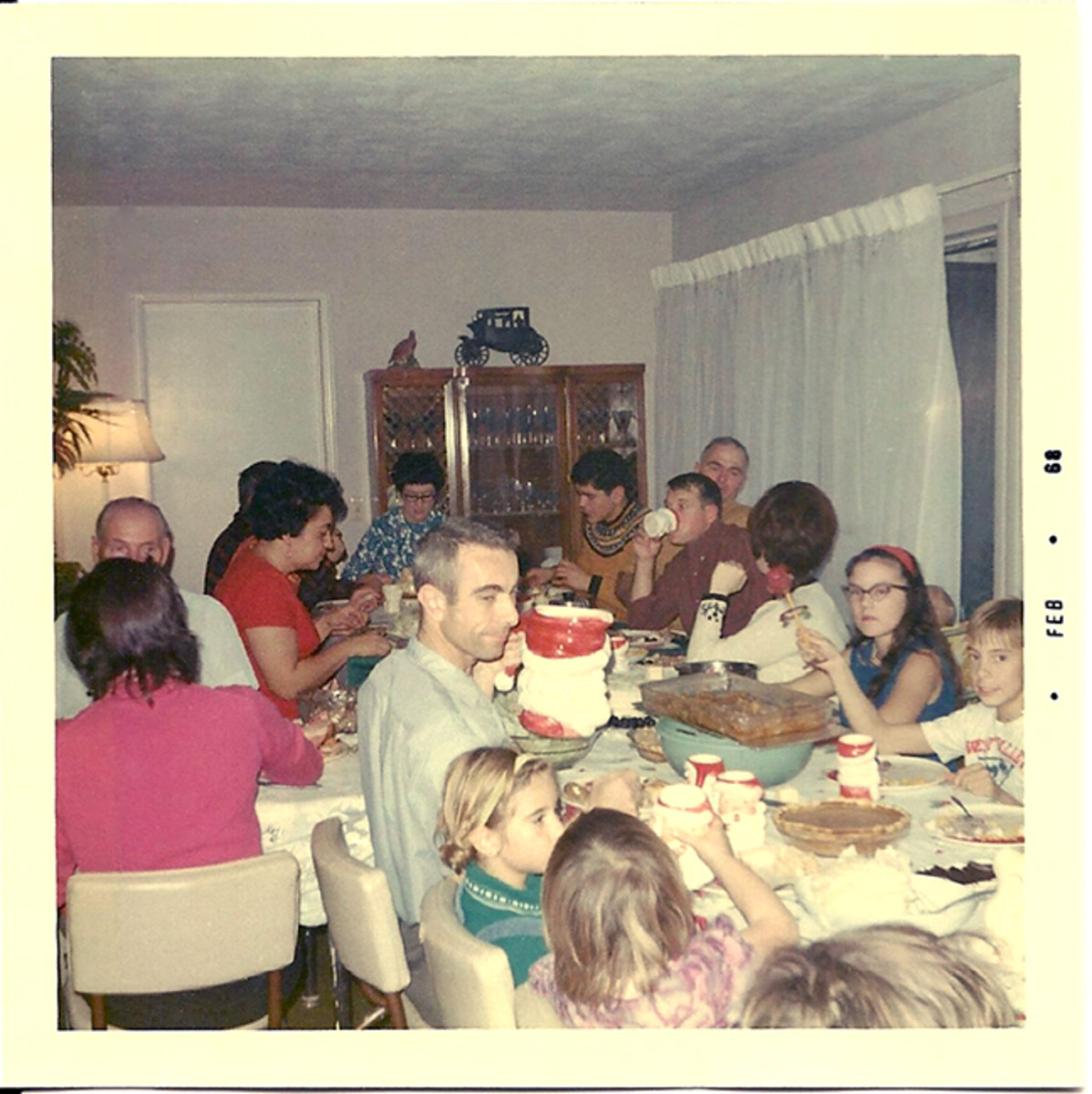 Christmas Dinner in the '60s.  I'm the dark haired girl with the cat-eye glasses on the right.
