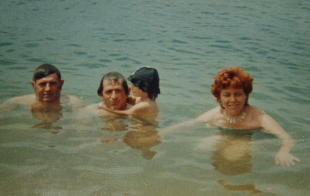 Me, my uncle, his wife and my dad enjoying a swim on the beach of a small island near Anchorage