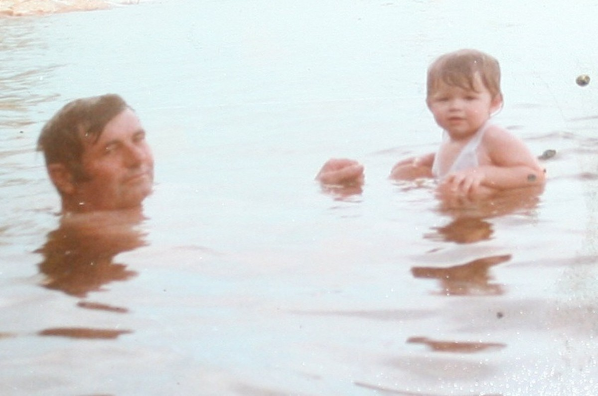 My dad and me lazing in the waters on the shore of one of the little islands