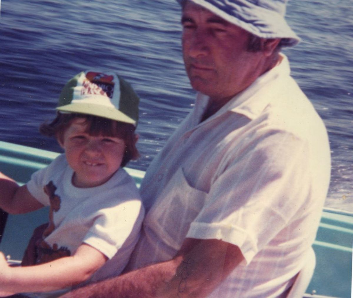 Dad teaching me to drive his boat