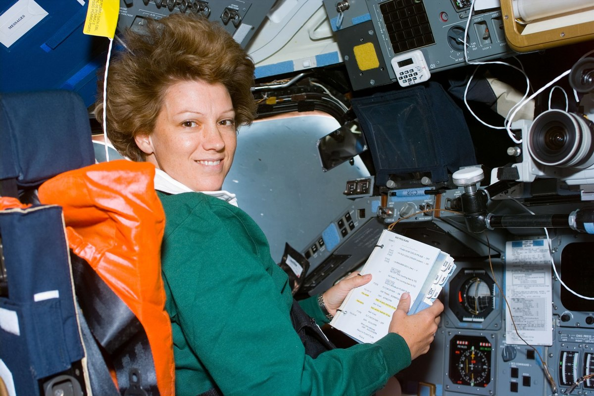 """Colonel Eileen M. Collins in Space Commanding the """"Columbia""""."""