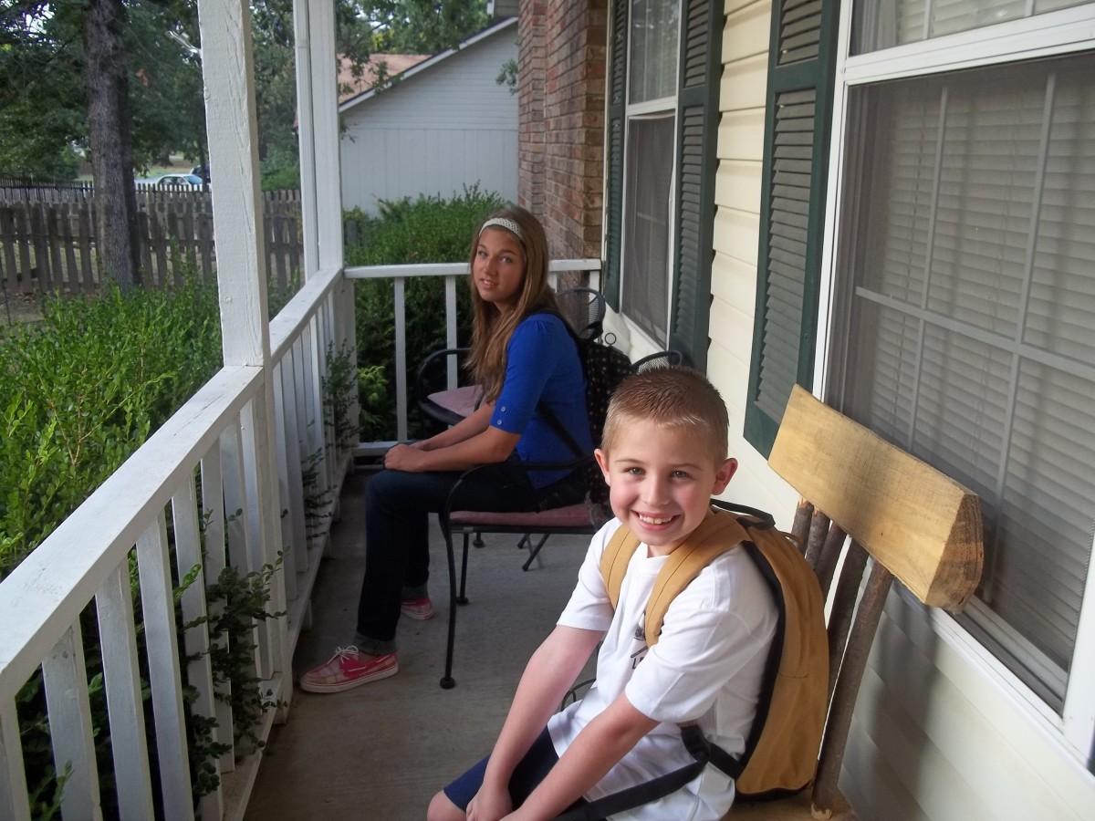 Lil' Britches and sis waiting on the bus for his first day of school