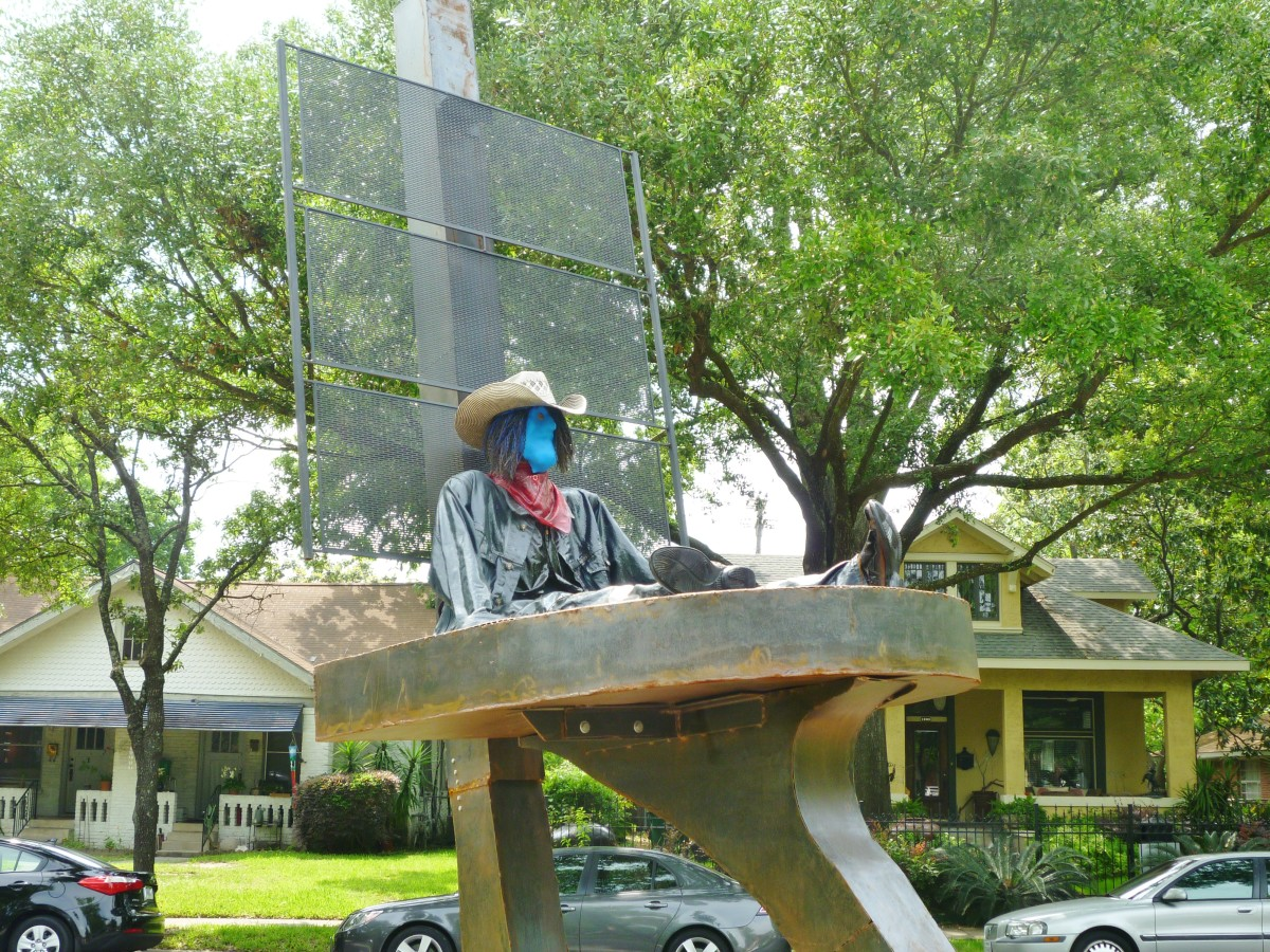 "View of ""Retired Cowboy Clown"" sculpture by Hans Molzberger in True South sculpture exhibit Houston"