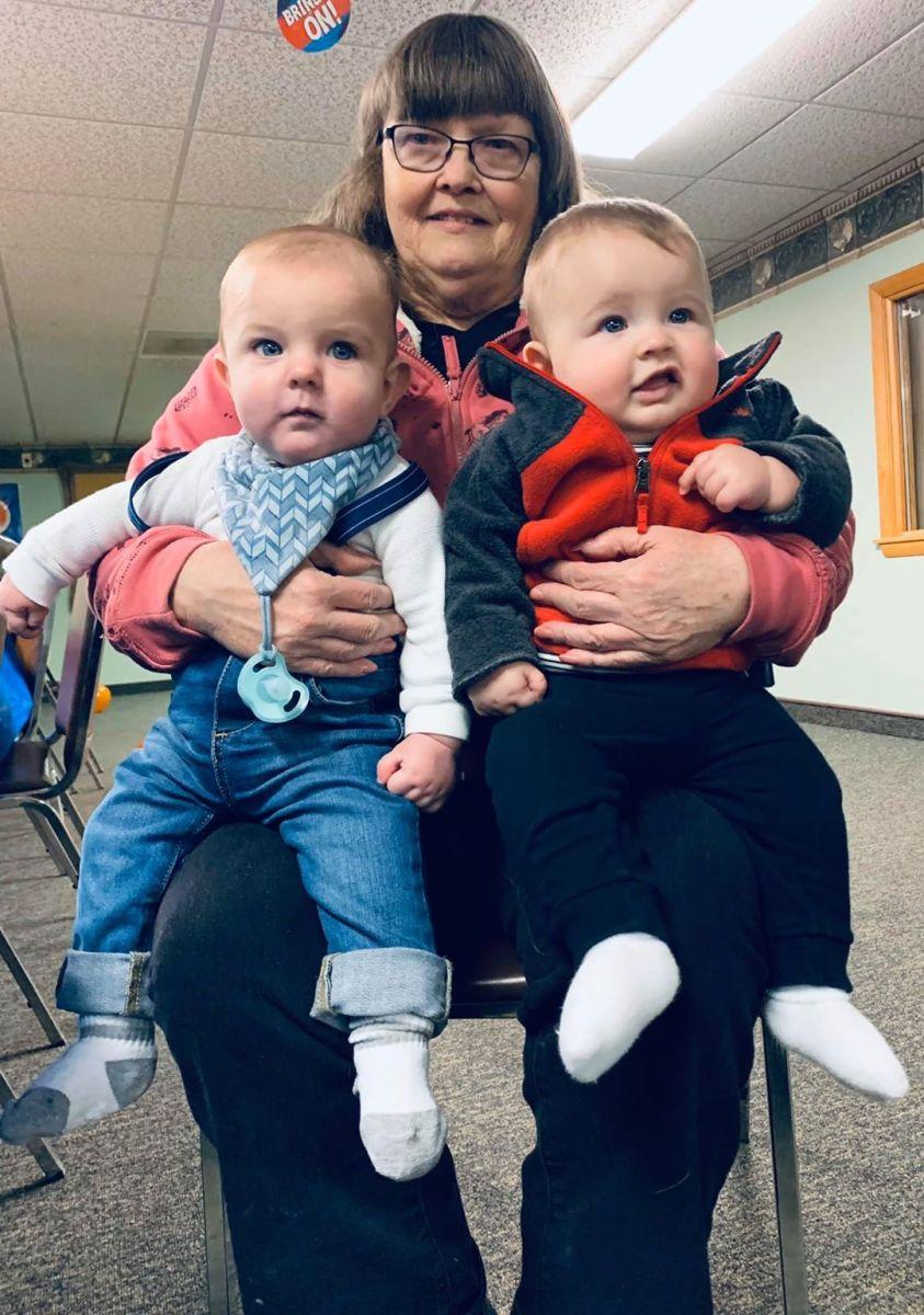 Babies Stone and Corbin on great grandma's lap