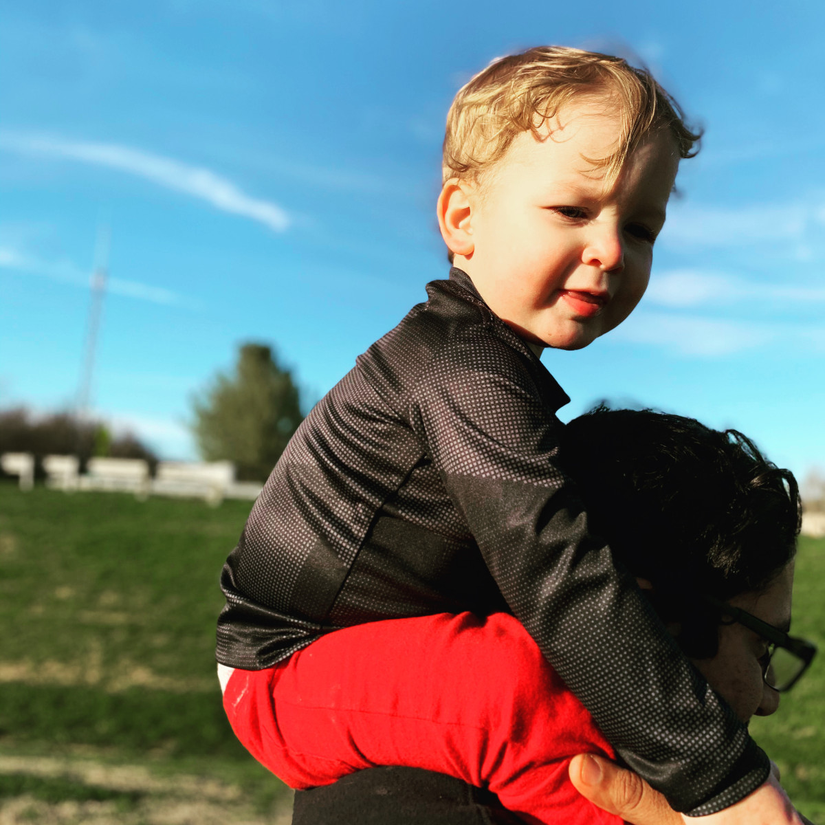 Grayson riding on daddy's shoulders during our walk around the neighborhood.