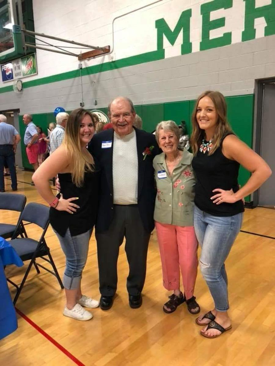 My daughters and my parents at an event in 2018 honoring my dad in his gymnasium. The gym was named McDonald Gymnasium after his retirement in 1993.