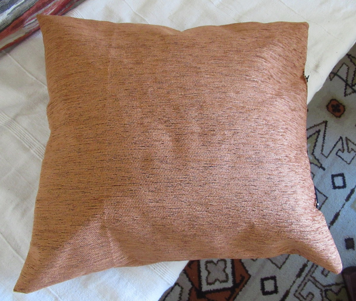 make cushions for the sitting room, out of left-over material.
