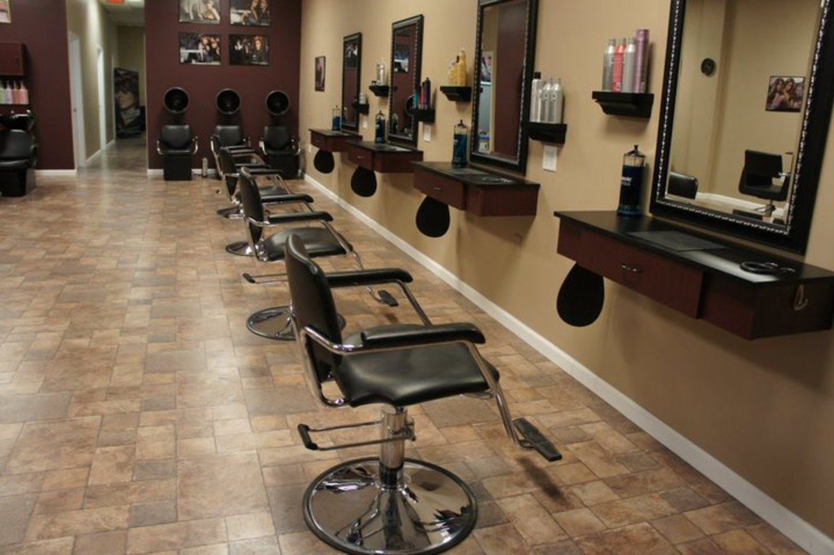 Styling stations with pneumatic chairs